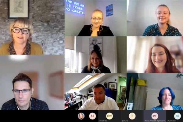 Advisory panel members are on a video call smiling at the camera.